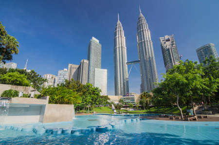 KUALA LUMPUR, MALAYSIA -MAY 11: Petronas Twin Towers at day on May 11, 2014 in Kuala Lumpur. Petronas Twin Towers were the tallest buildings (452 m) in the world from 1998 to 2004