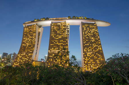 SINGAPORE - MAY 12: Night view at Marina Bay Sands Resort Hotel in Singapore on May 12, 2014. Luxury hotel and most expensive in world standalone casino property is main tourist attraction at city