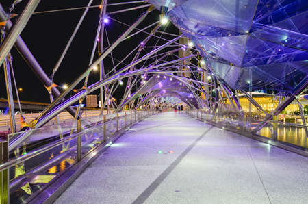 tonnes: SINGAPORE - MAY 12: The Helix Bridge on May 12, 2014 in Singapore. Is a bridge in the Marina Bay. The Helix is fabricated from 650 tonnes of Duplex Stainless Steel and 1000 tonnes of carbon steel Editorial