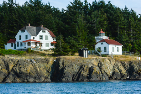 Lighthouse marking the islands along the eastern shore in Puget Sound, Washington State