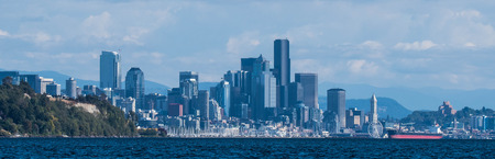 View of Seattle from Magnolia, taken from boat with Magnolia Bluff to the left and Smith Tower to the right Stock Photo
