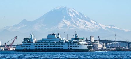 Washingon State ferry on Elliott Bay with Mount Rainier in the background.