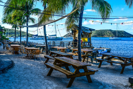 Evening breezes sway the palms on this idylic beach setting at a beachside bar on Virgin Gorda