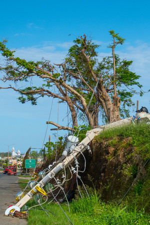 Damage to trees, powerlines, and building in Puerto Rico from Hurricane Maria, Sep 2017