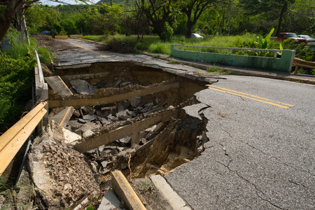 Many roads were destroyed by Hurricane Maria in September, 2017 and by the resulting flooding and soil saturation. Stockfoto