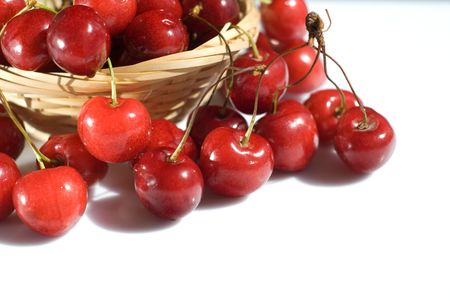 cherries in the basket isolated on white photo