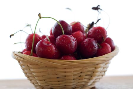 cherries in the basket isolated on white