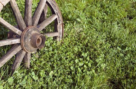 old wood farm wagon: Abandoned wheel