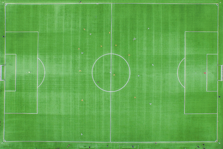 Classical stadium from birds eye view. Drone view. Green Football soccer field. Aerial footage. Imagens