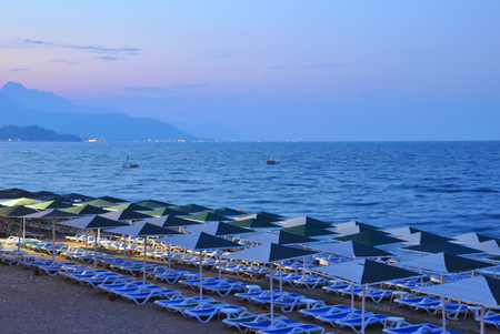 Beautiful beach with blue sea and mountains in Kemer, Turkey. Travel and vacation
