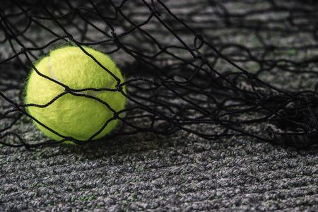 Tennis court and tennis ball. Tennis ball and tennis net