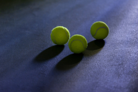 A lonely Tennis Ball on a Cour