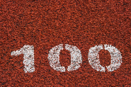 running track rubber standard red color and white line and number 100 Stock Photo