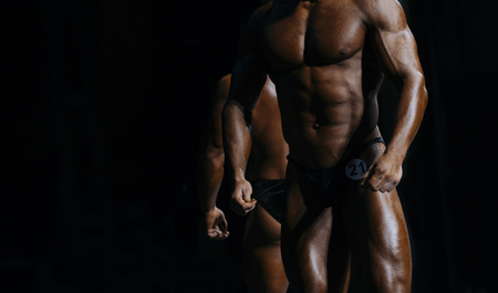 athletes bodybuilders posing most muscular bodybuilding competitions Stock Photo