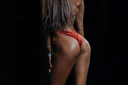 back woman sexy model butt iin swimsuit competition fitness bikini