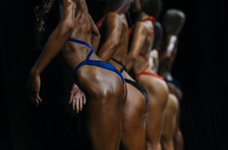 posing women in swimsuit competition fitness bikini