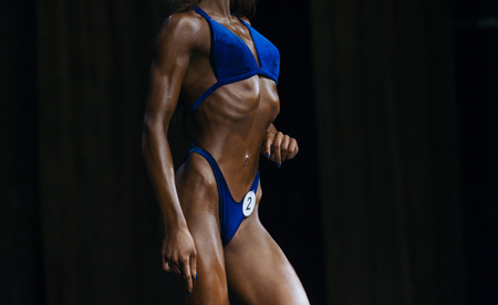 Woman in swimsuits competition fitness bikini. Bodybuilding sport. Strong woman Imagens