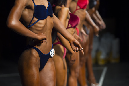 Woman in swimsuits competition fitness bikini