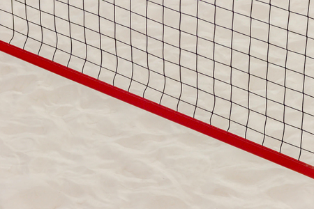 Volleyball net on the beach sand for background design