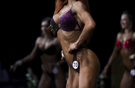 group woman athletes bodybuilders posing most muscular bikini fitness competitions 版權商用圖片