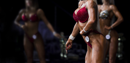 group woman athletes bodybuilders posing most muscular bikini fitness competitions 스톡 콘텐츠