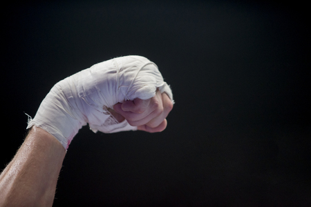 hand of fighter boxing lays ropes of ring Stock fotó