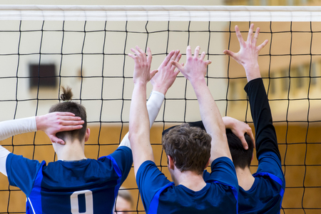 back view of a man volleyball player in action