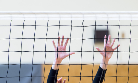 volleyball net with man hands