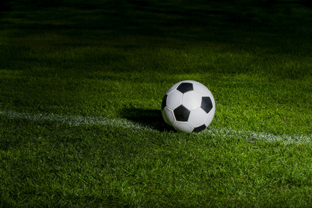 Black and white soccer ball in the field