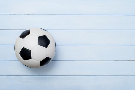 Soccer ball or football on blue wooden floor