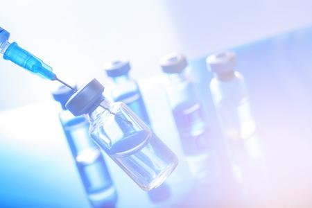 Medical concept Vaccination vaccine vial dose flu shot drug needle syringe