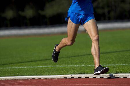 Athletics man running on the track field