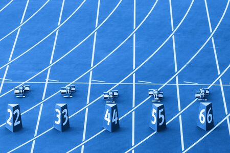 Starting blocks in track and field. Blue color filter