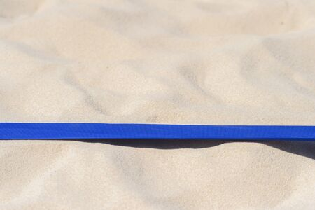 beach volleyball, soccer, handball court up close and in detail with blue plastic line marker