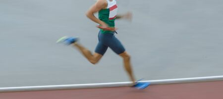Motion blurred view of a man running
