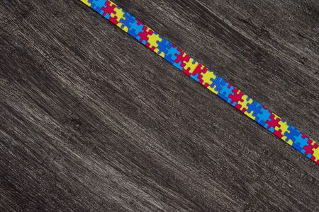 World Autism awareness and pride day with Puzzle pattern ribbon