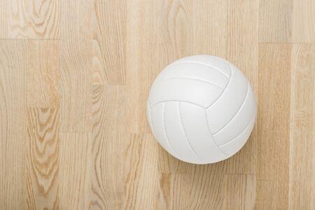 Close Up Of Volleyball Ball On Wooden Floor Reklamní fotografie