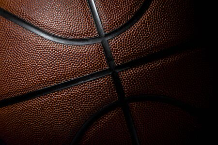 Closeup detail of basketball ball texture background