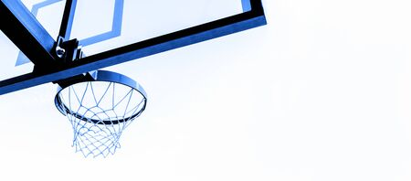 Basketball hoop isolated on white background. Blue filter.