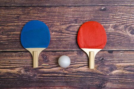Two rackets for playing table tennis on wooden background