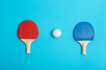 Two rackets for playing table tennis on blue background