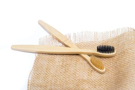 Bamboo tooth brush on white background