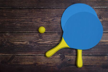Beach Tennis Racket Set. Beach paddle tennis racket set with rubber ball, on a wooden background