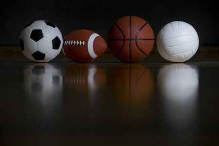 Close-up Of Various Sport Equipments Isolated On Black Background
