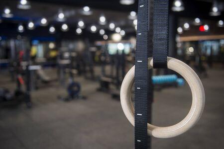 Gymnastic rings hanging at cross fitness box Banco de Imagens