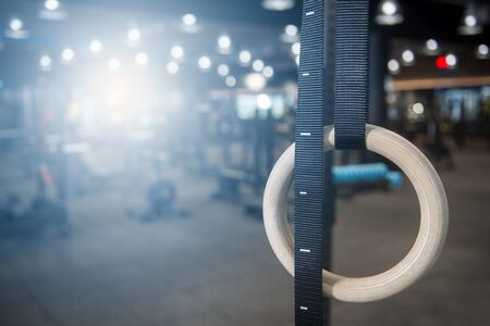 Gymnastic rings hanging at cross fitness box 스톡 콘텐츠