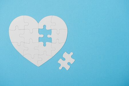 White Puzzle Heart Shape With Missing Piece, On Blue