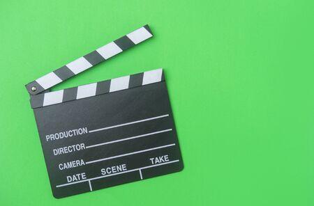 movie clapper on green background, cinema concept
