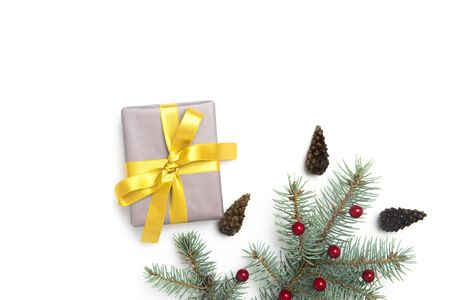 Christmas gift box with decoration on white background. Top view