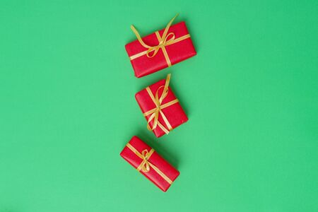 Christmas Gift Boxes Placed On Green Background Banco de Imagens